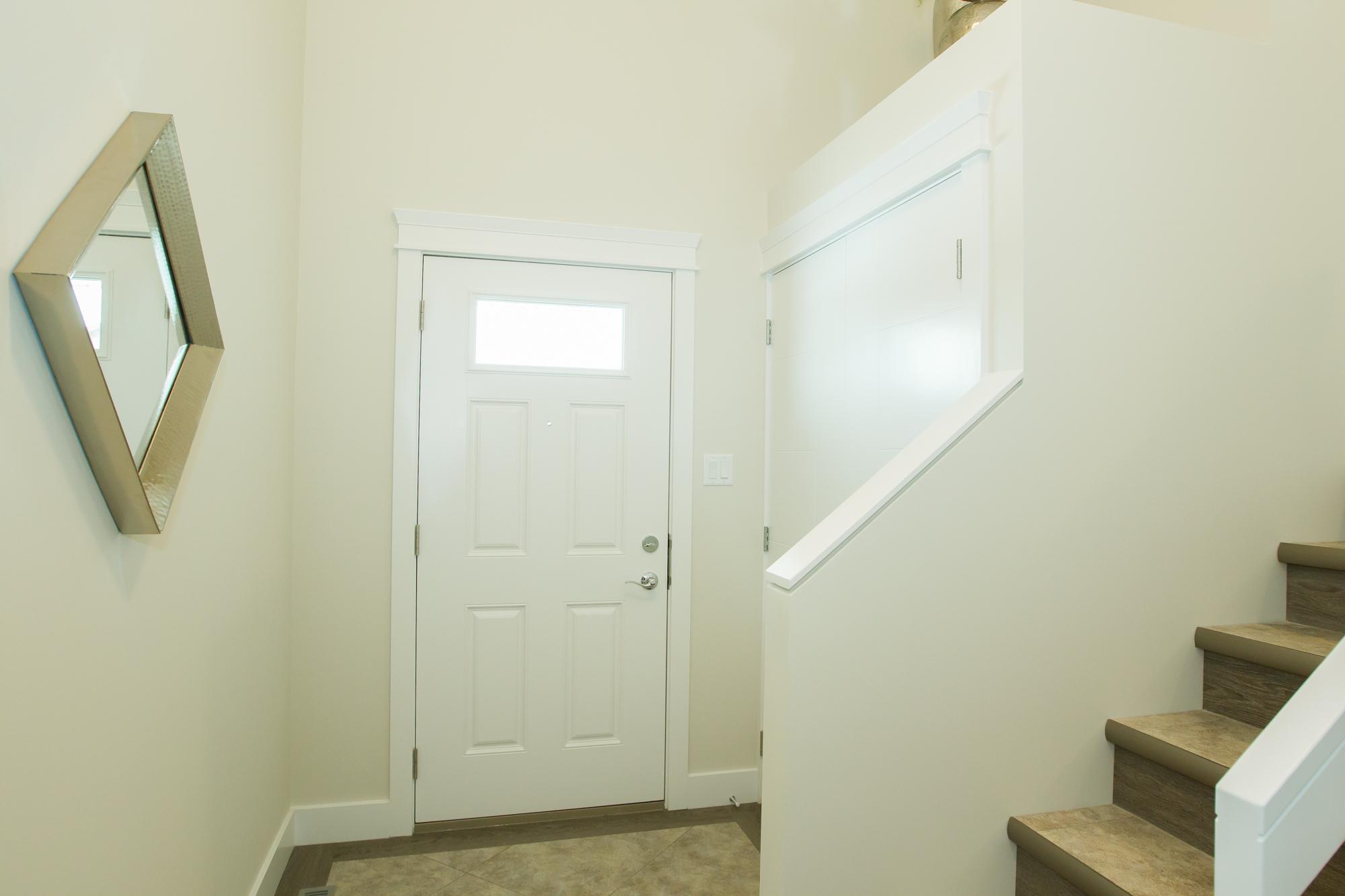 Entry in a Custom Net Zero Home in Lethbridge