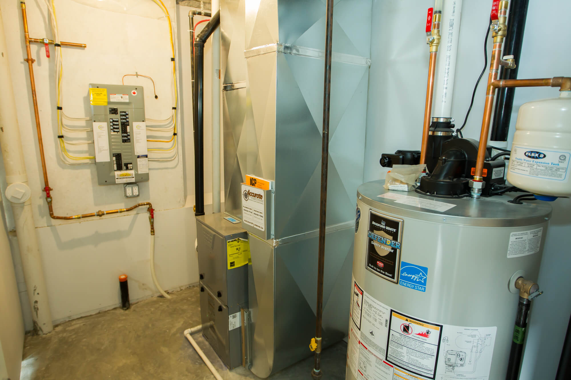 Mechanical Room in Lethbridge Home Featuring Energy Star Appliances