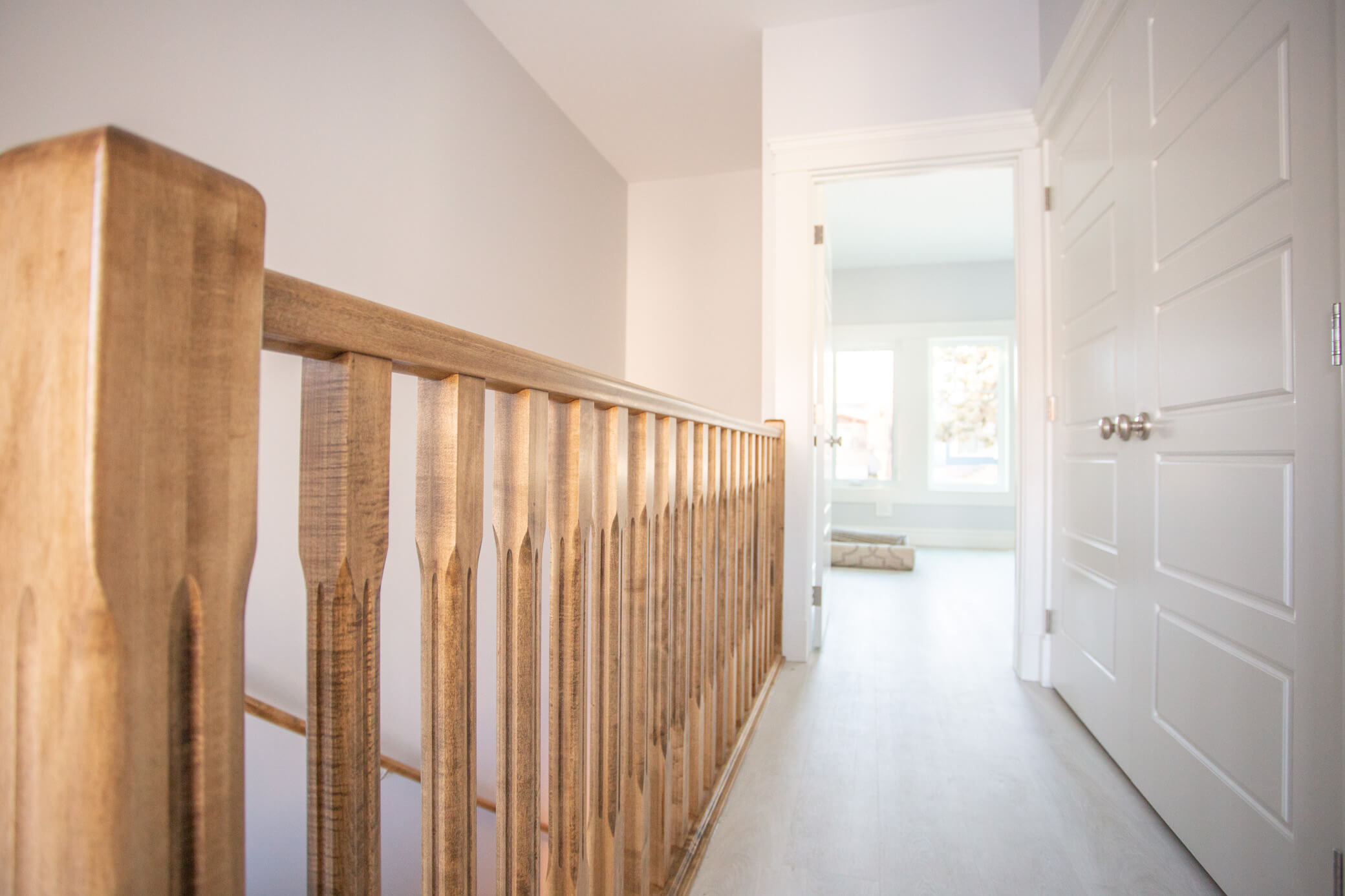 Handcrafted Maple railings in renovated Lethbridge home